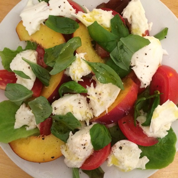 Tomatoes with peaches, basil and mozzarella cheese